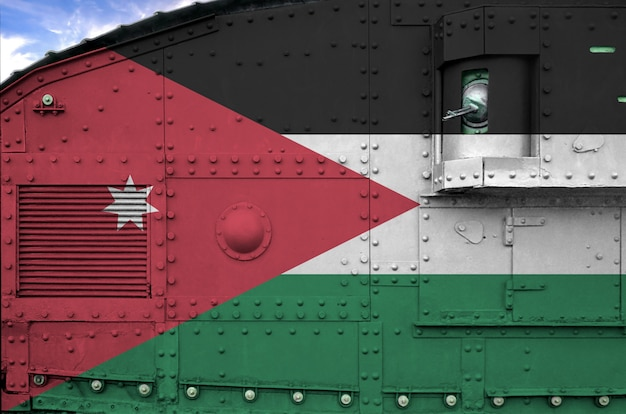 Jordan flag depicted on side part of military armored tank closeup.