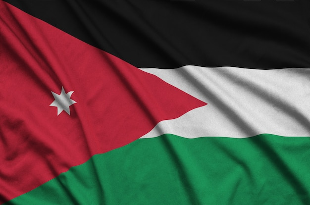 Jordan flag  is depicted on a sports cloth fabric with many folds.