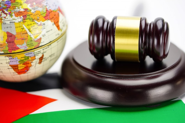 Jordan flag and judge hammer with globe world map. law and justice court concept.
