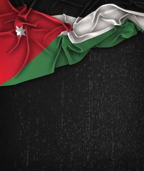 Jordan flag vintage on a grunge black chalkboard with space for text