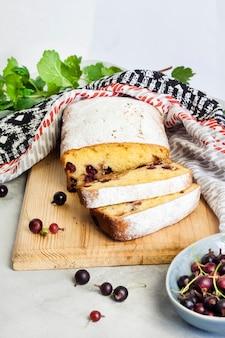 Jostaberry sponge cake on wooden cutting board