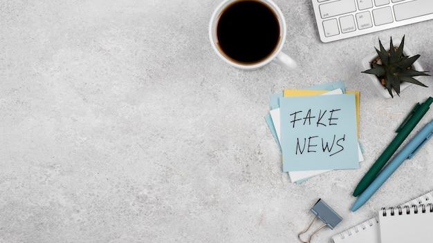 Journalist desk fake news above view