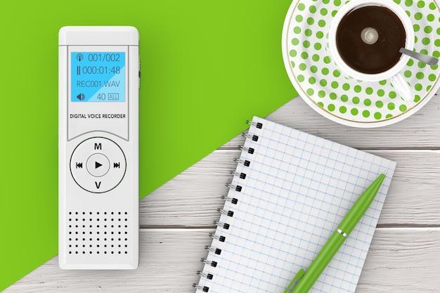ジャーナリストのデジタルボイスレコーダーまたはディクタフォン、木製のテーブルにペンとコーヒーのカップが付いた空白のメモ帳。 3dレンダリング