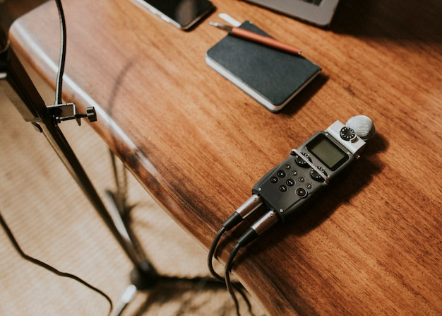 Journalist's  portable sound recorder on a wooden table