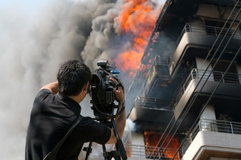 Journalist Video Compression fire brigade building.