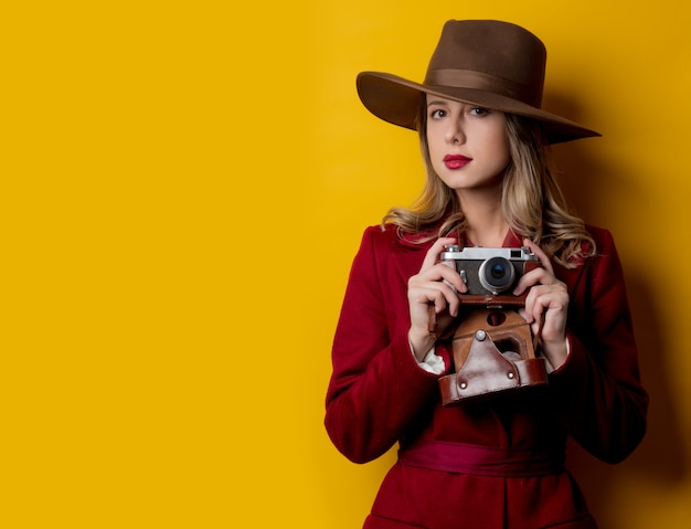 Journalist woman in hat with camera