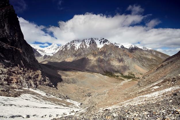 Journey through the altai mountains to  aktru. hiking to snowy peaks of the altai mountains