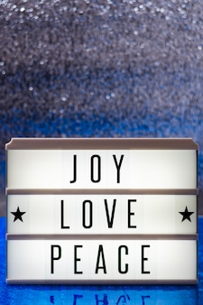 Joy love peace lettering with copy space