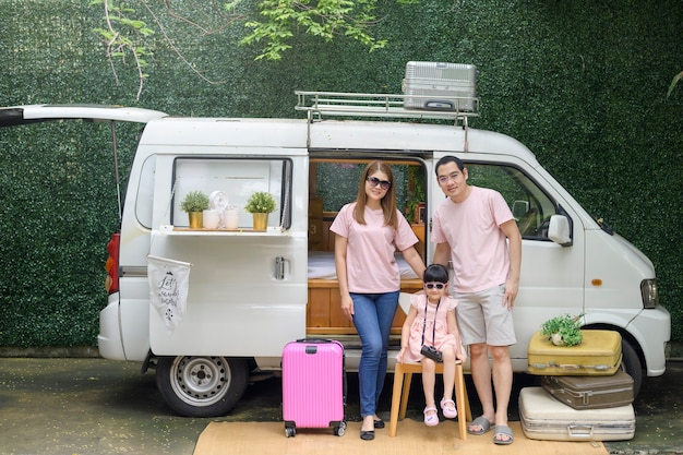 A joyful asian family enjoying road trip and journey is going on holiday, travel and tourism concept