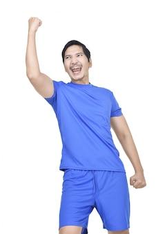 Joyful asian footballer celebrates win