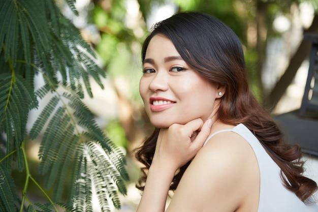 Joyful brunette in park