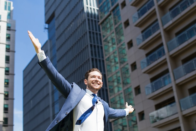 Joyful business leader celebrating success outside