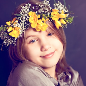 Joyful child girl with yellow flowers