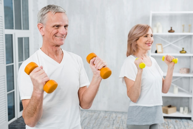 Joyful couple exercising at home