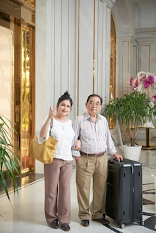 Joyful couple in hotel hall