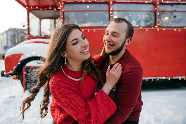 Joyful couple in love have fun outdoors in each other's hugs. high quality photo