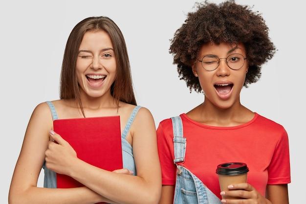 Joyful diverse girls blink eyes