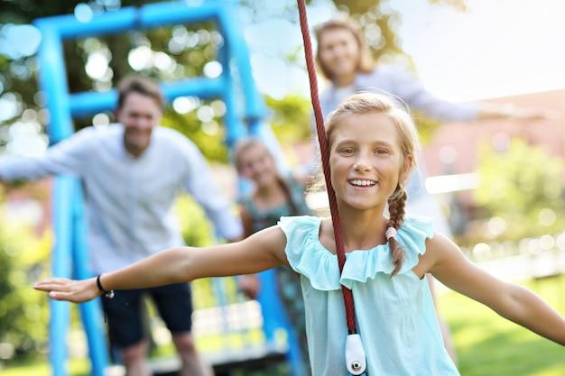 Joyful family having fun on playground