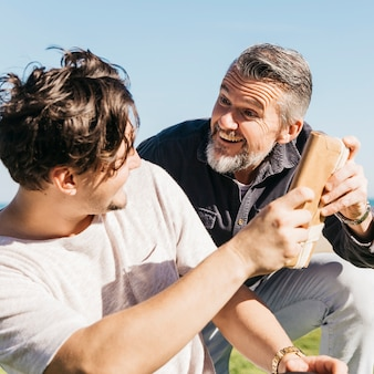 Joyful father receiving present from son