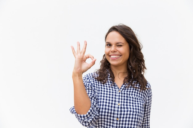 Joyful female customer making ok gesture