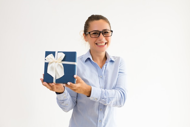Joyful female manager happy to receive present