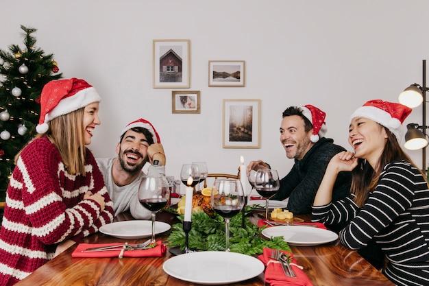 Joyful friends at christmas dinner