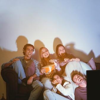 Joyful friends having a movie night