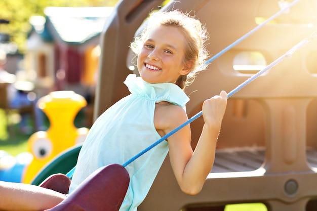 Joyful girl having fun on playground