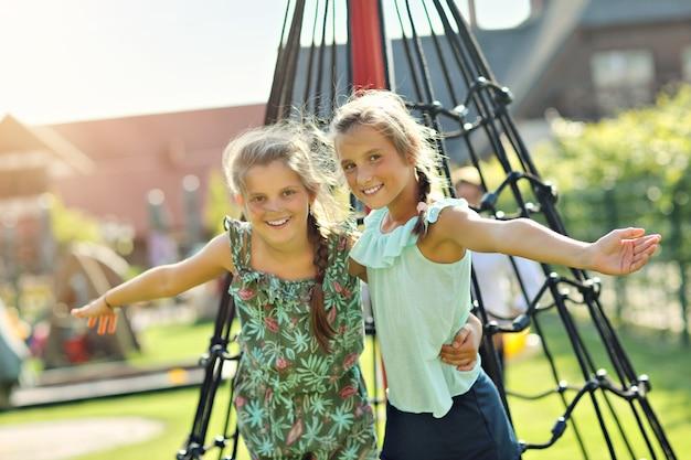 Joyful girls having fun on playground