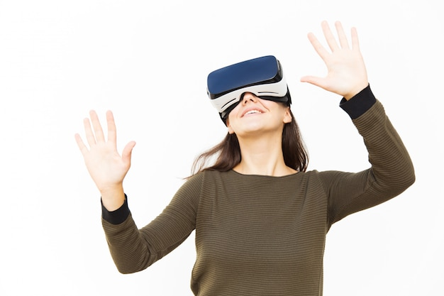 Joyful happy woman in vr headset touching air