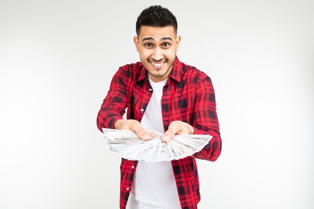 Joyful man boasting a prize holding out money on a white background