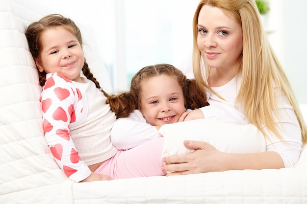 Joyful mother with her daughters