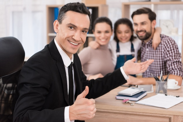 Joyful realtor made an advantageous offer to buy house