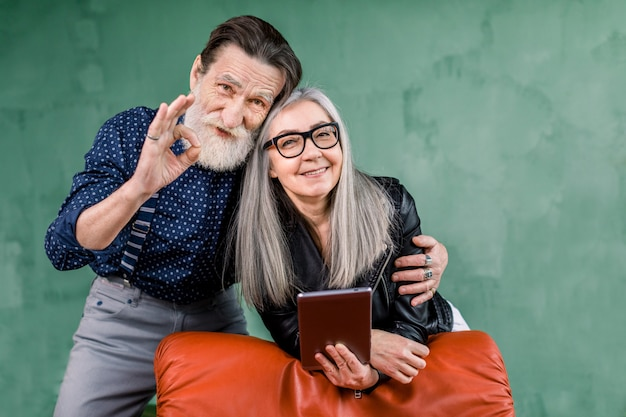 Joyful stylish mature couple spending their leisure time together