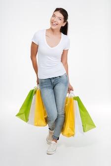 Joyful woman holding purchasings after shopping