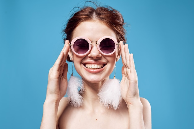 Joyful woman naked shoulders emotions studio fashion posing