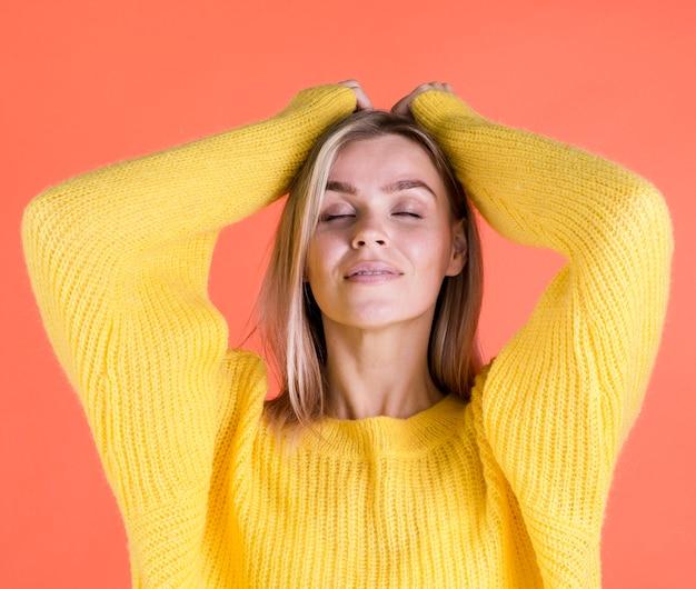 Joyful woman posing in studio
