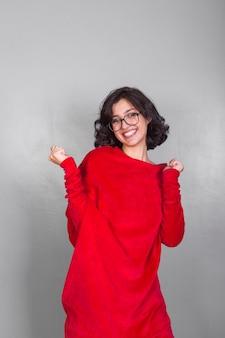 Joyful woman in red dress