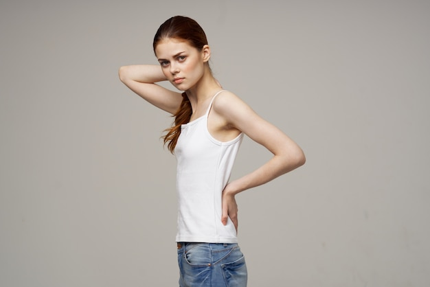 Joyful woman in white t-shirt joints warm up. high quality photo