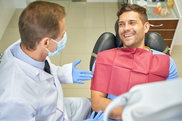 Joyous gentleman smiling at a dentist appointment