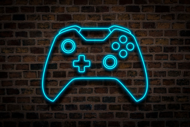 Joystick or gamepad, neon sign on a brick wall background. computer games concept, tournament.
