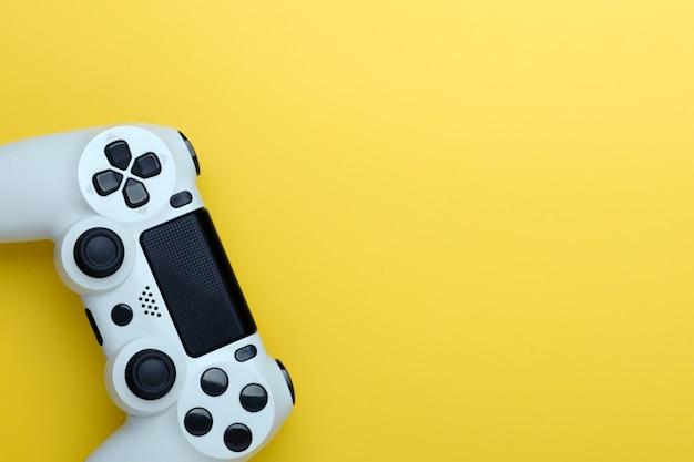 Joystick on yellow background