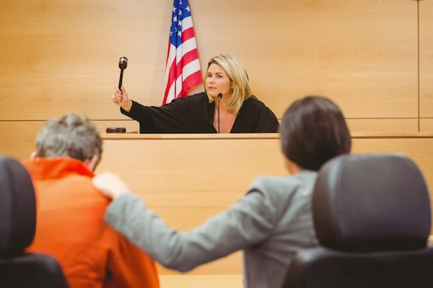 Judge about to bang gavel on sounding block