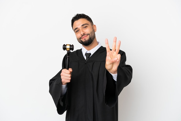 Judge arab man isolated on white background happy and counting three with fingers