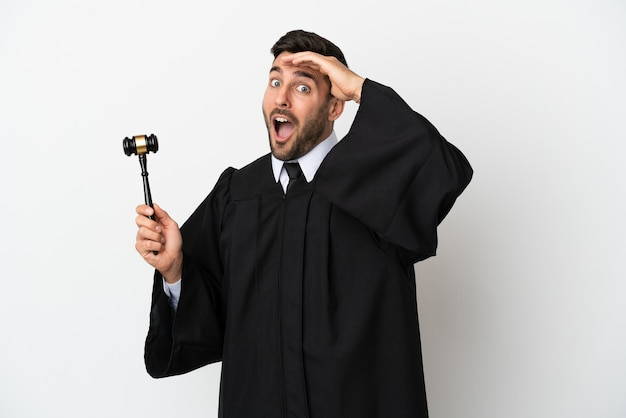 Judge caucasian man isolated on white background doing surprise gesture while looking to the side