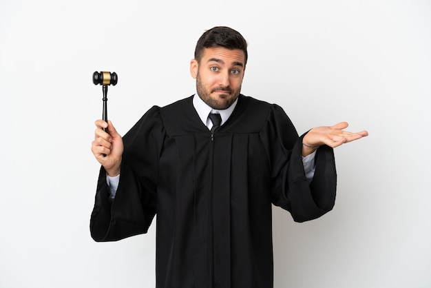 Judge caucasian man isolated on white background having doubts while raising hands