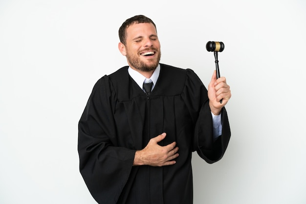 Judge caucasian man isolated on white background smiling a lot