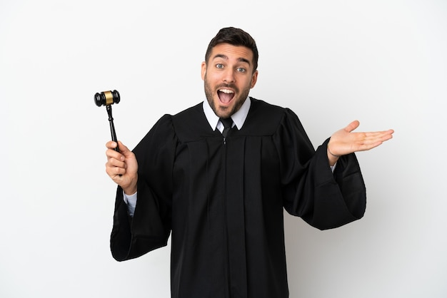 Judge caucasian man isolated on white background with shocked facial expression
