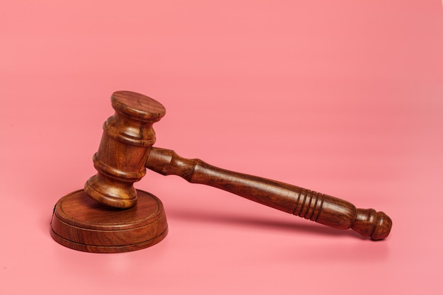 Judge gavel or auction on pink