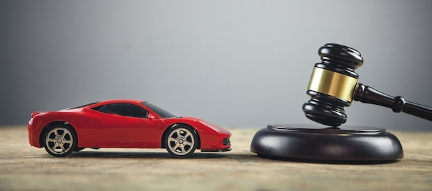 Judge gavel and car on the table. Premium Photo